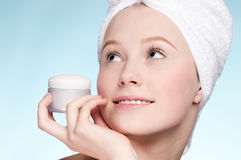 Beautiful woman tender jar of moisturizer cream Royalty Free Stock Images