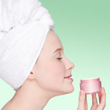 Beautiful woman tender jar of moisturizer cream Royalty Free Stock Image