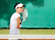 Beautiful woman at the tennis court Royalty Free Stock Photo