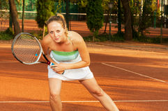 Beautiful woman tennis player on clay court Stock Image