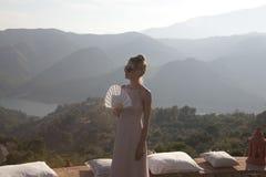 Beautiful woman on terrace Royalty Free Stock Image