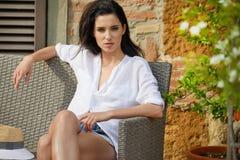 Beautiful woman on the terrace of an Italian country garden.  Stock Photo