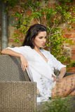 Beautiful woman on the terrace of an Italian country garden.  Stock Photography