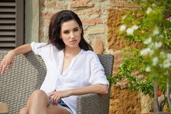 Beautiful woman on the terrace of an Italian country garden.  Royalty Free Stock Images