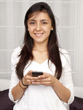 Beautiful woman texting Royalty Free Stock Photo