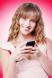Beautiful woman texting on her cellphone Stock Images