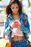 Beautiful woman texting with her phone Stock Photos