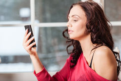 Beautiful woman texting with her phone Royalty Free Stock Photos