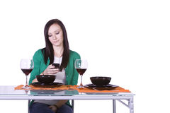 Beautiful Woman Texting at the Table Royalty Free Stock Images
