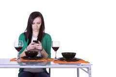 Beautiful Woman Texting at the Table Stock Photography