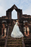 Beautiful woman in Thai traditional dress. With Jasmine Thai Garland standing in front of ancient monumant Stock Images