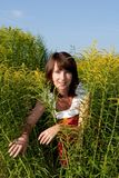 Beautiful woman in a thicket of grass Royalty Free Stock Images