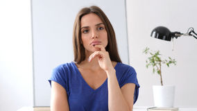 Beautiful Woman Thinking, Day Dreaming. High quality Stock Photography