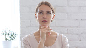 Beautiful Woman Thinking, Day Dreaming. High quality Stock Photo