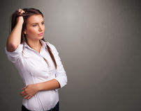 Beautiful woman thinking with empty copy space Stock Images