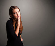 Beautiful woman thinking with empty copy space Stock Image
