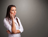 Beautiful woman thinking with empty copy space Royalty Free Stock Image