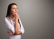 Beautiful woman thinking with empty copy space Royalty Free Stock Photo