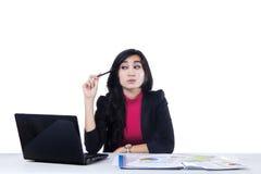 Beautiful woman thinking idea in office 1 Royalty Free Stock Photo