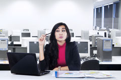 Beautiful woman thinking idea in office Stock Images