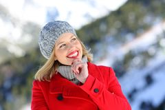 Beautiful woman thinking in the mountain in winter Royalty Free Stock Image