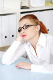 Beautiful woman thinking in the office. Stock Photography