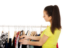 Beautiful woman thinking what to dress. Stock Photography