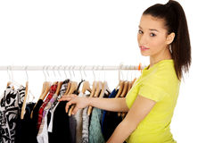 Beautiful woman thinking what to dress. Stock Photos