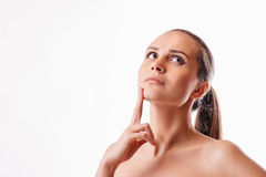 Beautiful woman thinking on a white background. Beautiful girl thinking on a white background Royalty Free Stock Images
