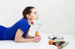 Beautiful woman  thinks about repairs Royalty Free Stock Photos