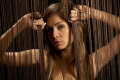 Beautiful woman with threads Royalty Free Stock Photos