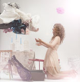 Beautiful woman throw all the clothes Stock Photography