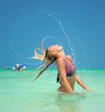 Beautiful woman throw back hair from the water Royalty Free Stock Photo