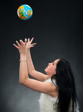 Beautiful woman holding a globe Royalty Free Stock Images