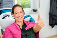 Woman with thumb up in  barber shop Royalty Free Stock Photos