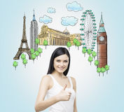 Beautiful woman with thumb up. Sketches of the most famous places on the light blue background. The concept of tourism and sightse Stock Photo