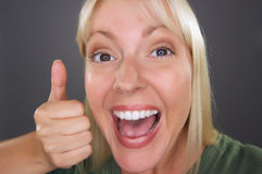 Beautiful Woman with a Thumbs Up Stock Image