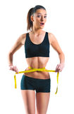 Beautiful woman with a tinny waist and a measuring tape Stock Photography