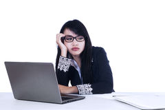 Beautiful woman tired at work Stock Image