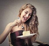Beautiful woman about to eat a cake Royalty Free Stock Image