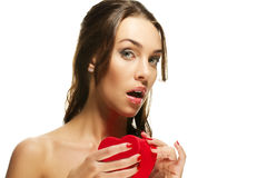 Beautiful woman about to open a red heart shaped b Stock Image