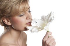 Beautiful woman to smell flower.  close up Stock Image