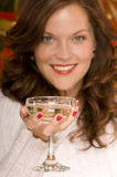 Beautiful woman toasting with champagne. Portrait of beautiful woman toasting with a coupe of champagne, blurred background Stock Photography