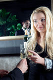 Beautiful woman toasting her partner Royalty Free Stock Photography