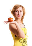 Beautiful woman with a tomato Stock Images