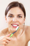 Beautiful woman with tooth-brush l Stock Photos