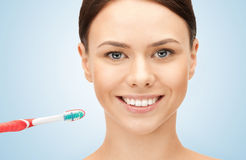 Beautiful woman with toothbrush Stock Images