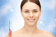 Beautiful woman with toothbrush Stock Photos