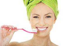 Beautiful woman with toothbrush. Stock Photography