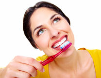 Beautiful woman with a toothbrush. Royalty Free Stock Image
